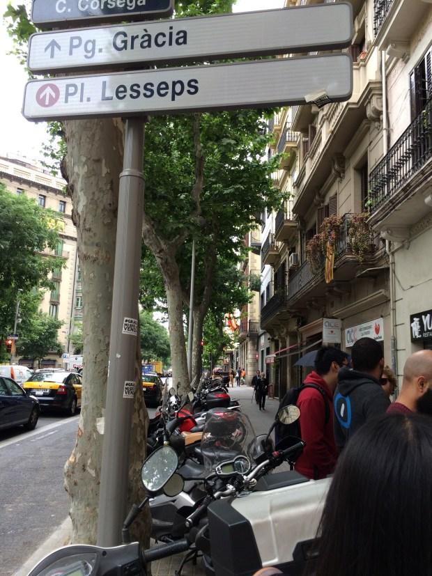 Motorbikes parked on sidewalks.