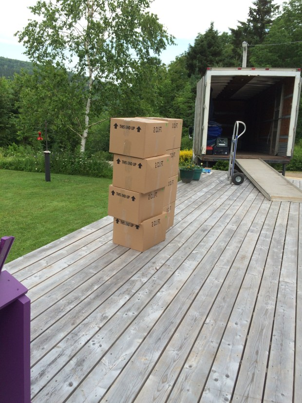 Stack of boxes on the front deck.