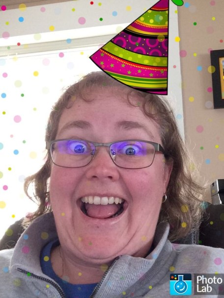 Picture of me with a birthday hat on.