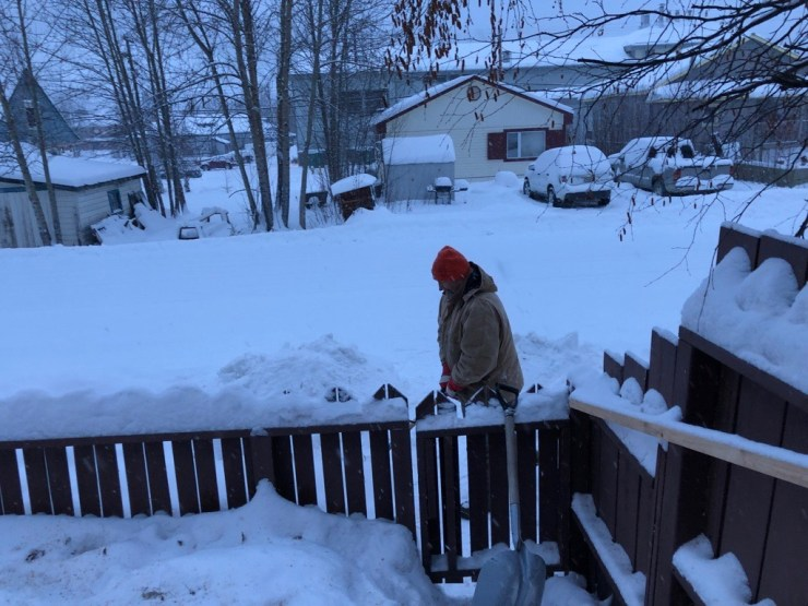 Jeff shovelling the front wooden sidewalk