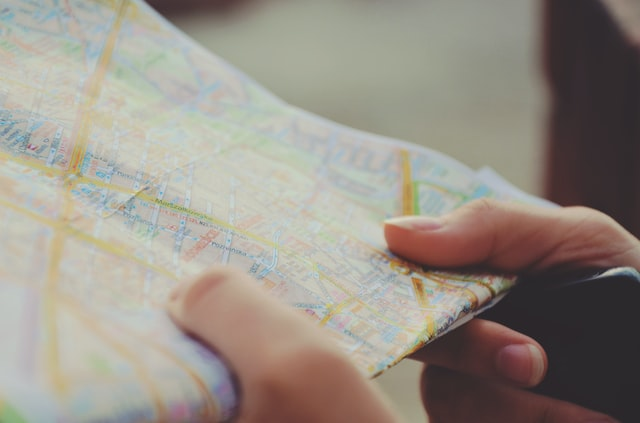 Person holding map to a better life
