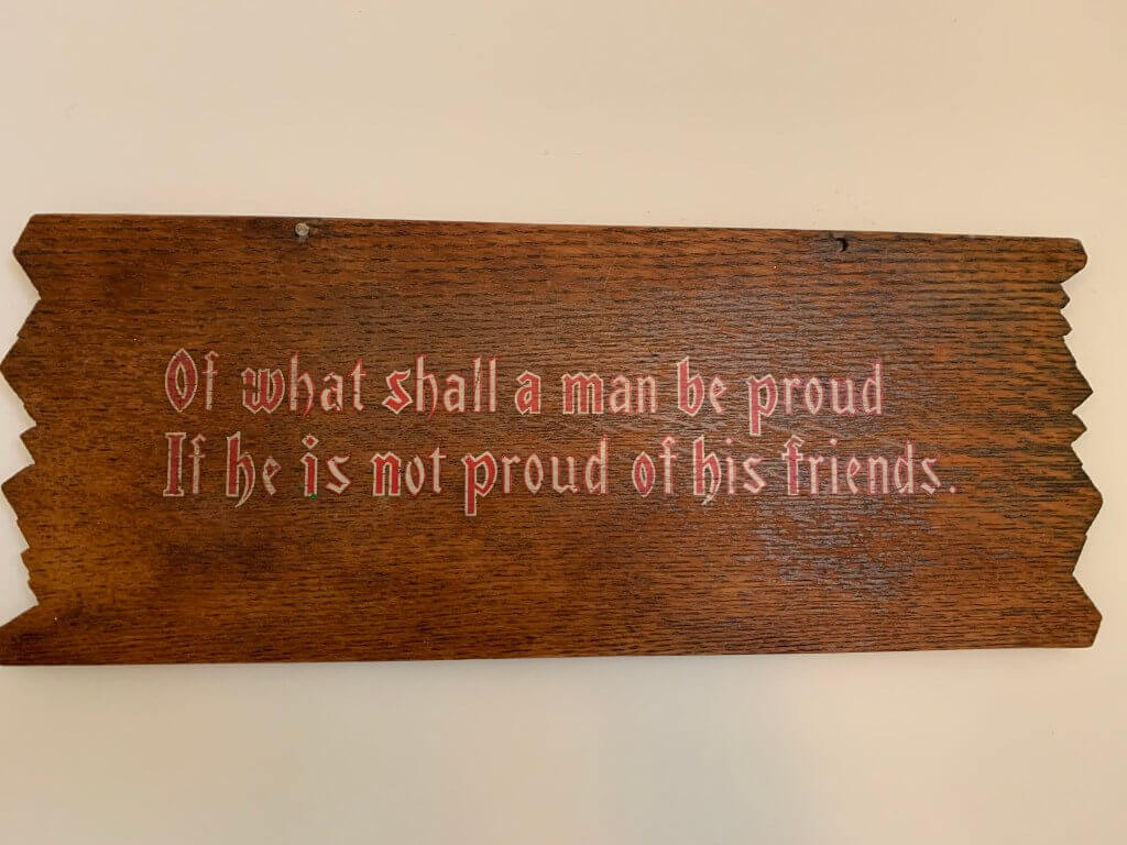 Wooden sign quote about how friends are important to a happy life