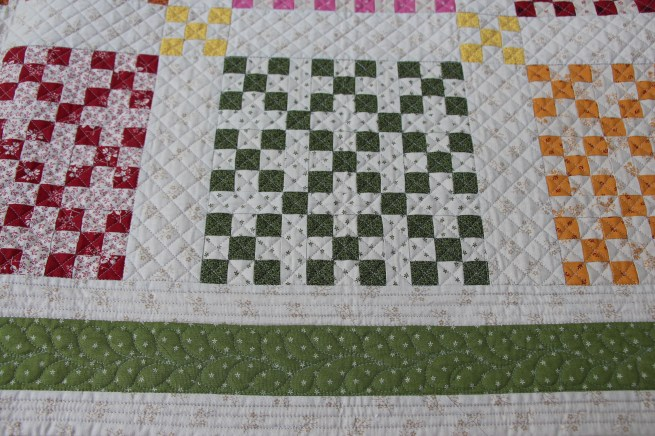 close-up of penny candy quilted by Valerie Krueger