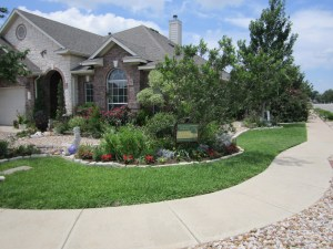 Reduced sod, river rock nuisance strips and lush Xerophytic beds.