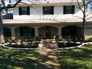 After...a small change make a huge impact on the street view and accentuate the large porch and windows to the home.