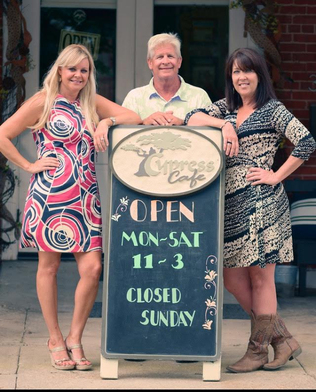 Holly Lemoine-Raymond (left) with new Cypress Café  owners  Steve and Sue Forstall.