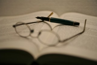 journal and glasses