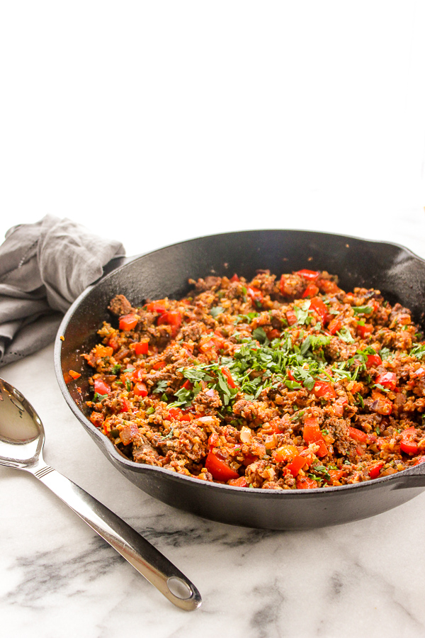 Spanish Cauliflower Rice is a healthy, low-carb version of the traditional dish. It's full of delicious flavor and is quick and easy, making it perfect for weeknight dinners. | lisasdinnertimedish.com