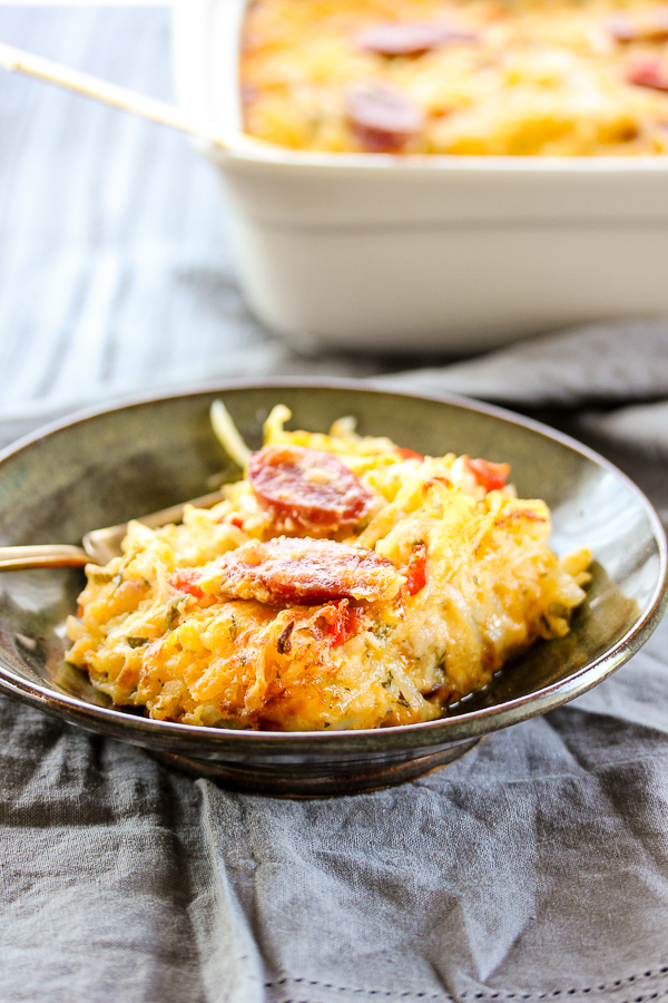 Cheesy Hash Brown Bratwurst Brunch Bake is sure to please this Mother's day with its cheesy goodness and the smoky flavor from Klement's smoked bratwurst.