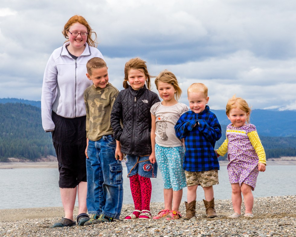 6 of my kiddos standing on the beach in front of a river! Kids are an asset to your business.