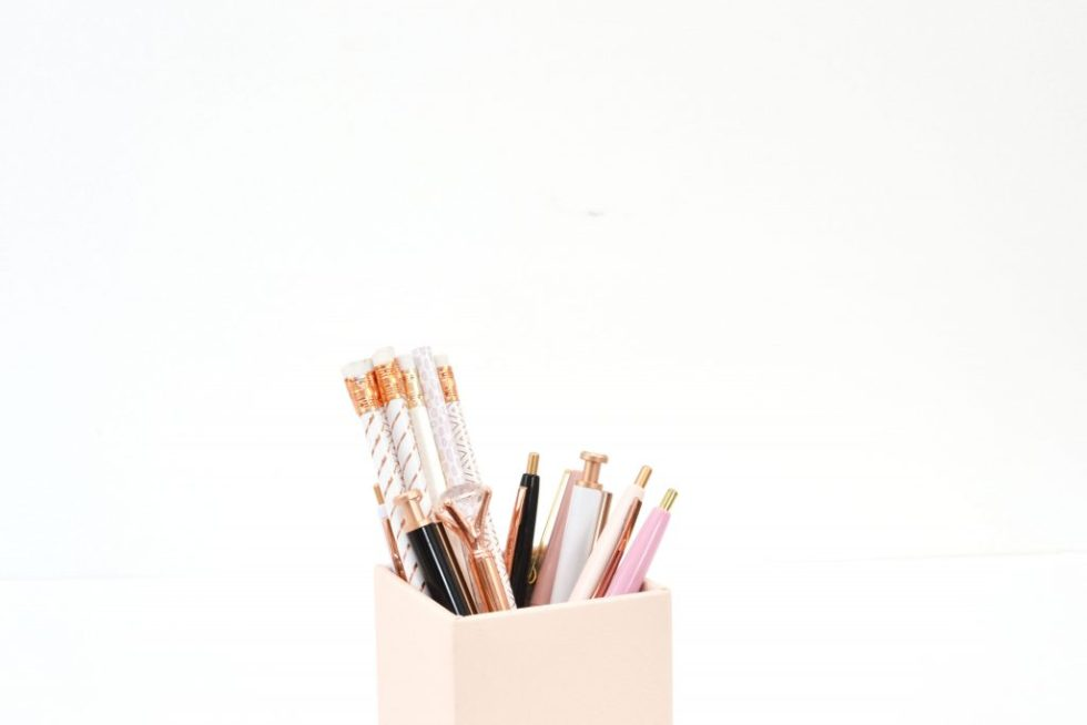A pencil holder holding pens and pencils.