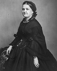 "Mary Todd Lincoln in mourning clothes, 1863. Even during the period in 1862 and 1863 when Mrs. Lincoln was in mourning for her son Willie and wore only black, she managed to go further into debt for new clothes. By 1864, she told Elizabeth Keckley: ""The President glances at my rich dresses and is happy to believe that the few hundred dollars that I obtain from him supply all my wants. I must dress in costly materials. The people scrutinize every article that I wear with critical curiosity... If he is elected, I can keep him in ignorance of my affairs, but if he is defeated, then the bills will be sent.""3 Only on January 1, 1865 did she completely shed her mourning attire."