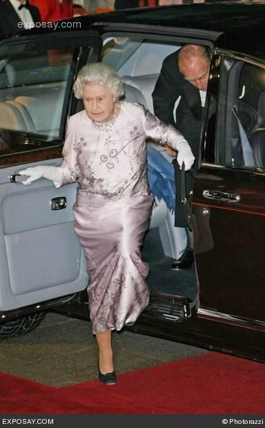 Queen Elizabeth (with black leather purse) and Prince Philip arrive at the Casino Royale World Premiere - Red Carpet - Nov. 14, 2006, London