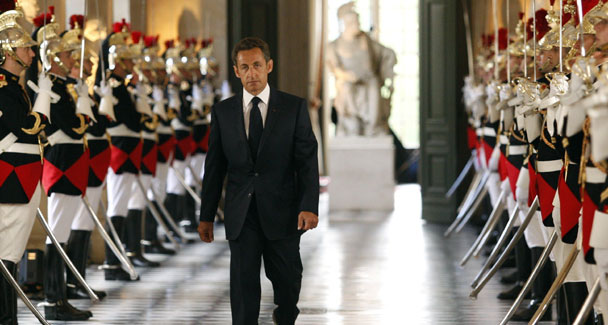 """French President Nicolas Sarkost arrives at Versailles Palace on June 22, 2009, to address Parliament. H condemned the use of the burqa in France, calling it an unacceptable symbol of """"enslavement."""""""