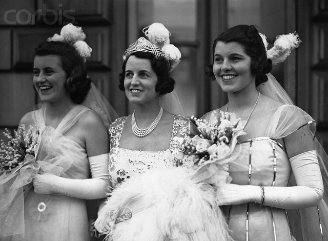 "Rose Kennedy, wife of newly-appointed American ambassador to Great Britain, Joseph Kennedy, is shown at center with two of her daughters, Kathleen ""Kick"" Kennedy (l) and Rosemary, at their 1938 presentation at Buckingham Palace. Kathleen's 1944 marriage to Billy Harrington, the Marquess of Hartington, an Anglican, infuriated the intensely Catholic Rose Kennedy, who refused to attend the wedding. Widowed just four months later, Kathleen fell in love with a very married man, Peter Wentworth-Fitzwilliam, 8th Earl Fitzwilliam, and became his mistress. Rose was further incensed - because he, like Billy, wasn't a Catholic. Over her mother's objections, Kathleen and Peter planned to wed after his divorce. Instead, in a 1948 trip to the south of France, they both died in a plane crash. No one but Kathleen Kennedy Cavendish's father, Joseph P. Kennedy, attended her funeral in Devonshire, England, in the Cavendish family plot. It has been said that Rose Kennedy discouraged Kathleen's eight surviving siblings from attending the service of their sister."
