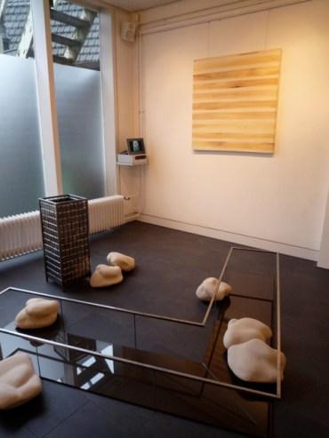 "Foreground: Habitat, 2010, steel, stoneware, glas, hardboard. Background: Half of ""Passe Partout"", 2008, acrylic on canvas"