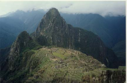 Photo I took October 1999, on a ledge overlooking Machu Picchu. That is Huyana Picchu in the distance.