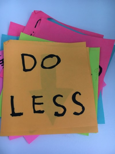 A stack of post-its saying Do Less