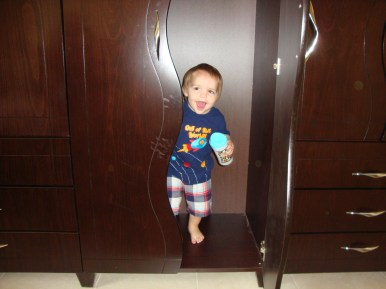 Davy playing in our closet/wardrobe.