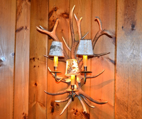 One last Antler sconce with bark shades leaves leads you back to the start of the tour