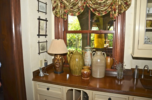 Love the Southern pottery collection under the kitchen window