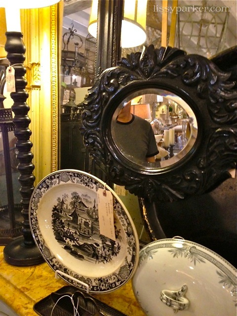 Small mirrors and china to tempt the eye