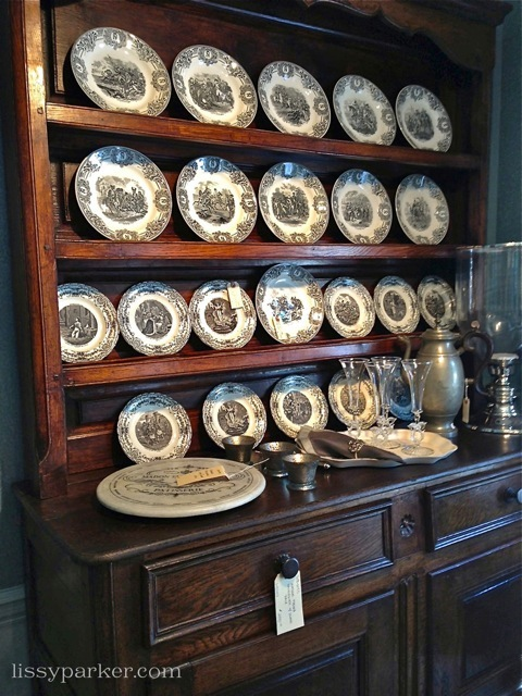 Another larger cabinet—and a set of antique china