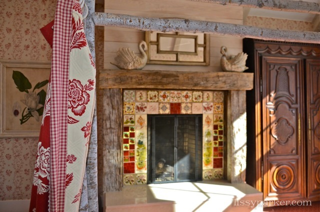 Warm those Winter nights with a fireplace surrounded by Antique Minton Tiles and a rustic beam mantle