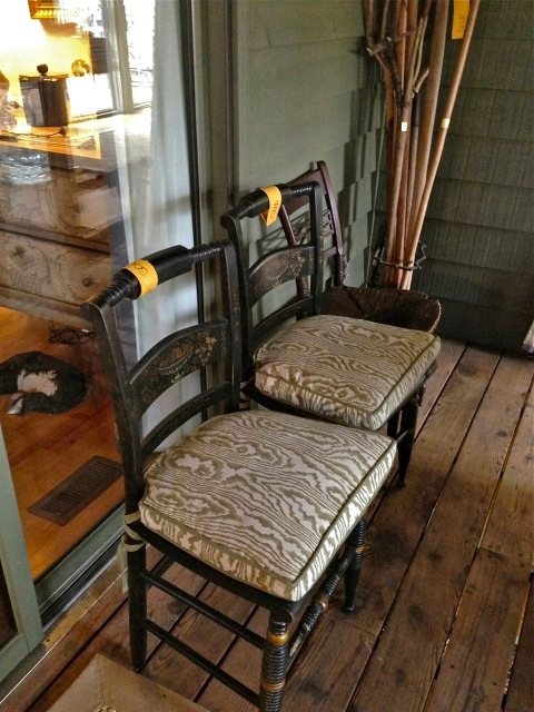 Great painted chairs were a set of six on the screened in porch—anyone know whose fabric this is