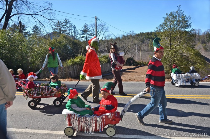Large elves pulled small elves in seasonal wagons