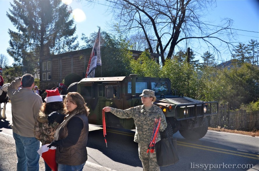 Army soldiers with Hummers  were passing out gifts