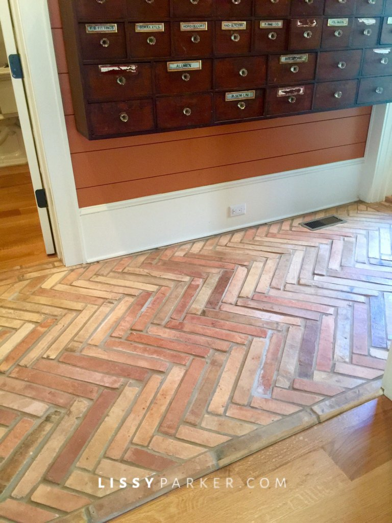 Antique French tile cover the back hall floors