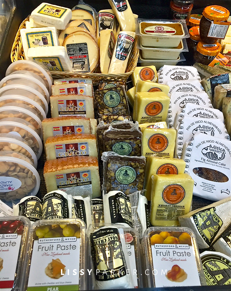 Cheese selections displayed in a glass case