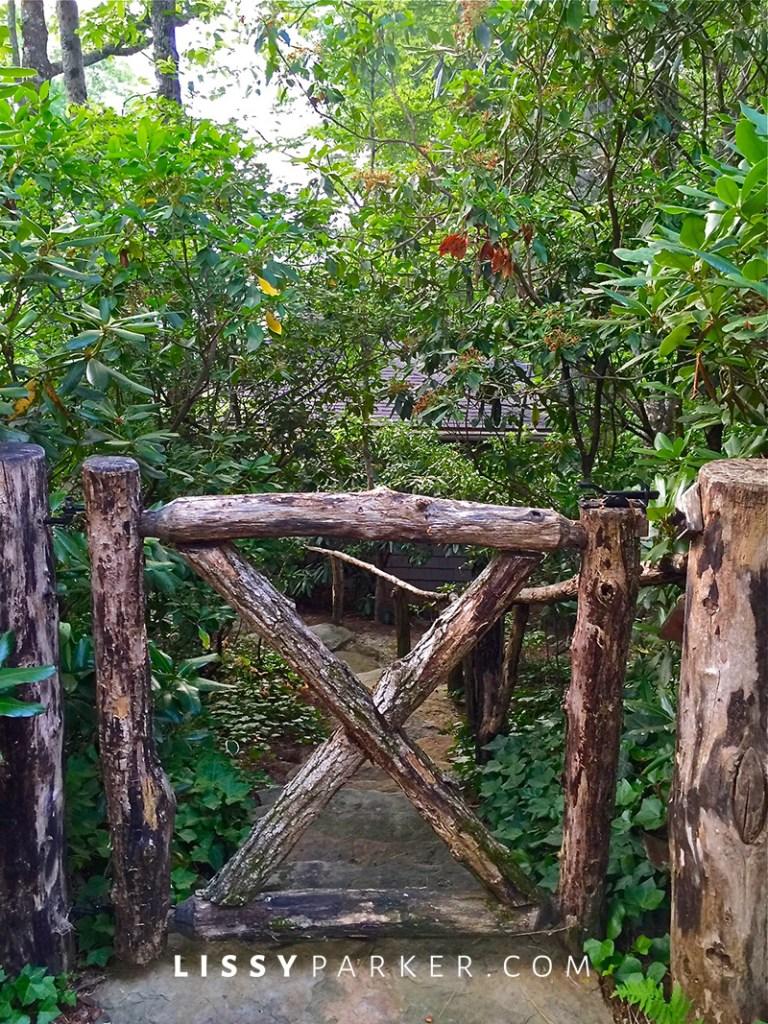 house crush locust rail gate to the guest house