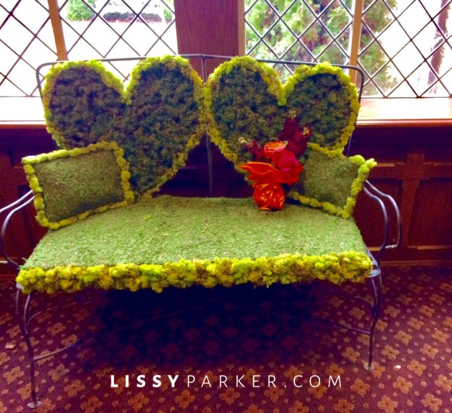 Love seat and floral arrangments