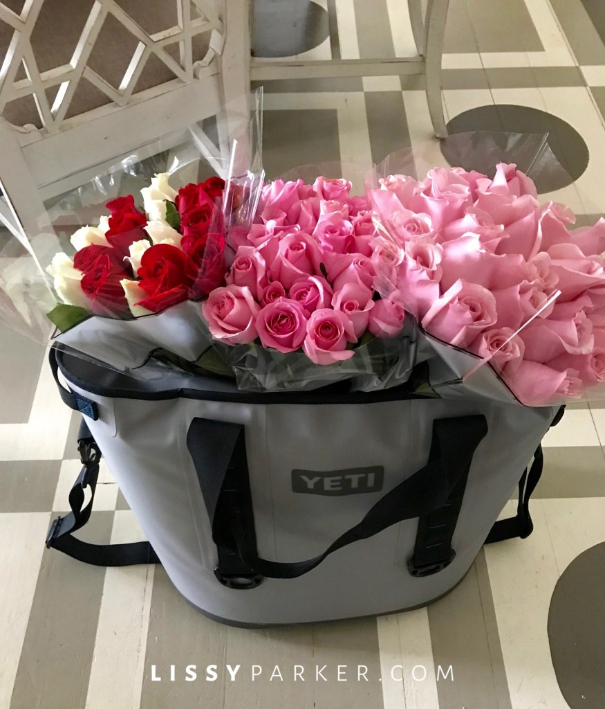 yeti coler full of pink and wite roses
