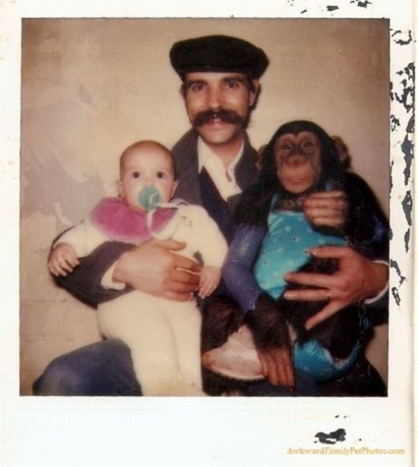 man holding baby and monkey