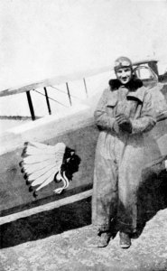 James Norman Hall standing next to his biplane with the logo of the Lafayette Escadrille Lafayette Escadrille escadrille emblem