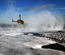 Helicopters taking off to show tourists the melting glacier as evidence of global warming