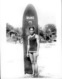 Duke Kahanamoku with his surf board