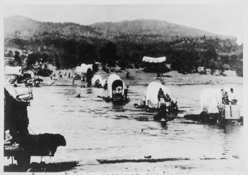 Wagon Train, crossing a river,  bringing emigrant families from the east to the new west