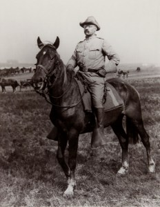 "Theodore Roosevelt on horseback leading his ""Rough Riders"" in Cuba"