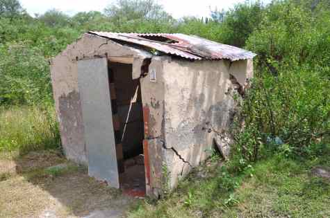 One of the destroyed bath huts close to the crack.