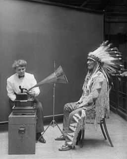 Frances Densmore at the Smithsonian Institution in 1916 during a recording session with Blackfoot chief for the Bureau of American Ethnology.