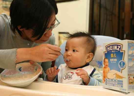 A-Mother-Is-Feeding-Heinz-Baby