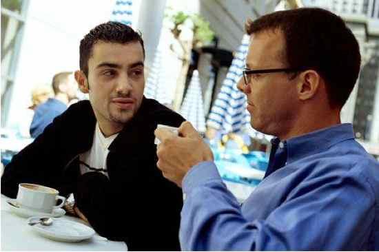 Two-Guys-Talking-In-Coffeeshop
