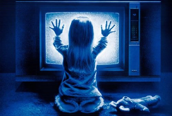 Kid sitting in front of TV with static