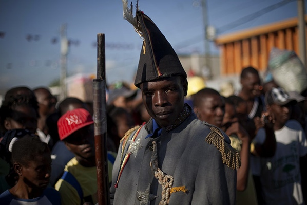 Port-Au-Prince-Haiti-A-Man-Dressed-As-A-Colonial-Soldier-Parades-During-A-Ceremony-To-Mark-The-205Th-Anniversary-Of-The-Killing-Of-Jean-Jacques-Dessalines-A-Leader-Of-The-Haitian-Revolution-Against-France