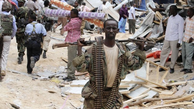 A Somali government soldier patrols a section of Bakara market in Mogadishu