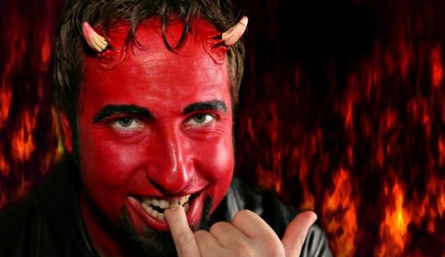Devil man biting on pinky finger
